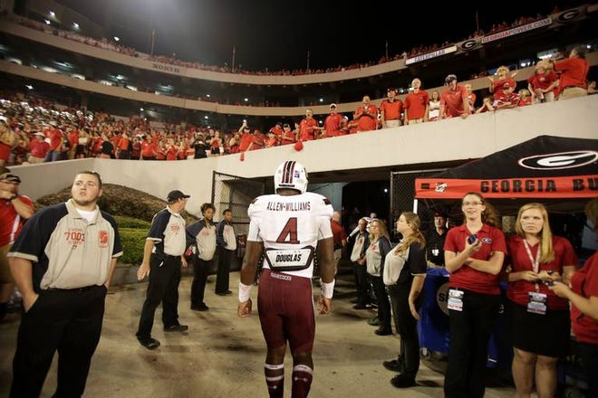 South Carolina Gamecocks linebacker Bryson Allen-Williams (4) walks off the field after a loss to Georgia at Sanford Stadium in Athens, Ga, Saturday, Sept. 19, 2015.