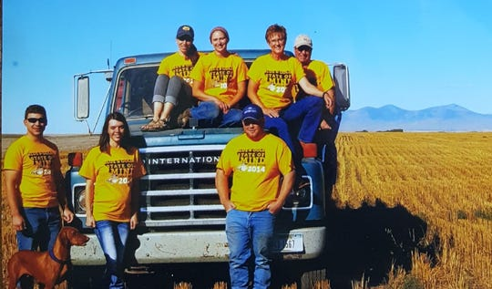 The Tom Bangs family includes, from left, Josh and Katie (Bangs) Strissel, atop car Katie (Adam) Bangs, family friend Stennie, Carol and Tom Bangs, and standing at right in front, Jeff Bangs.