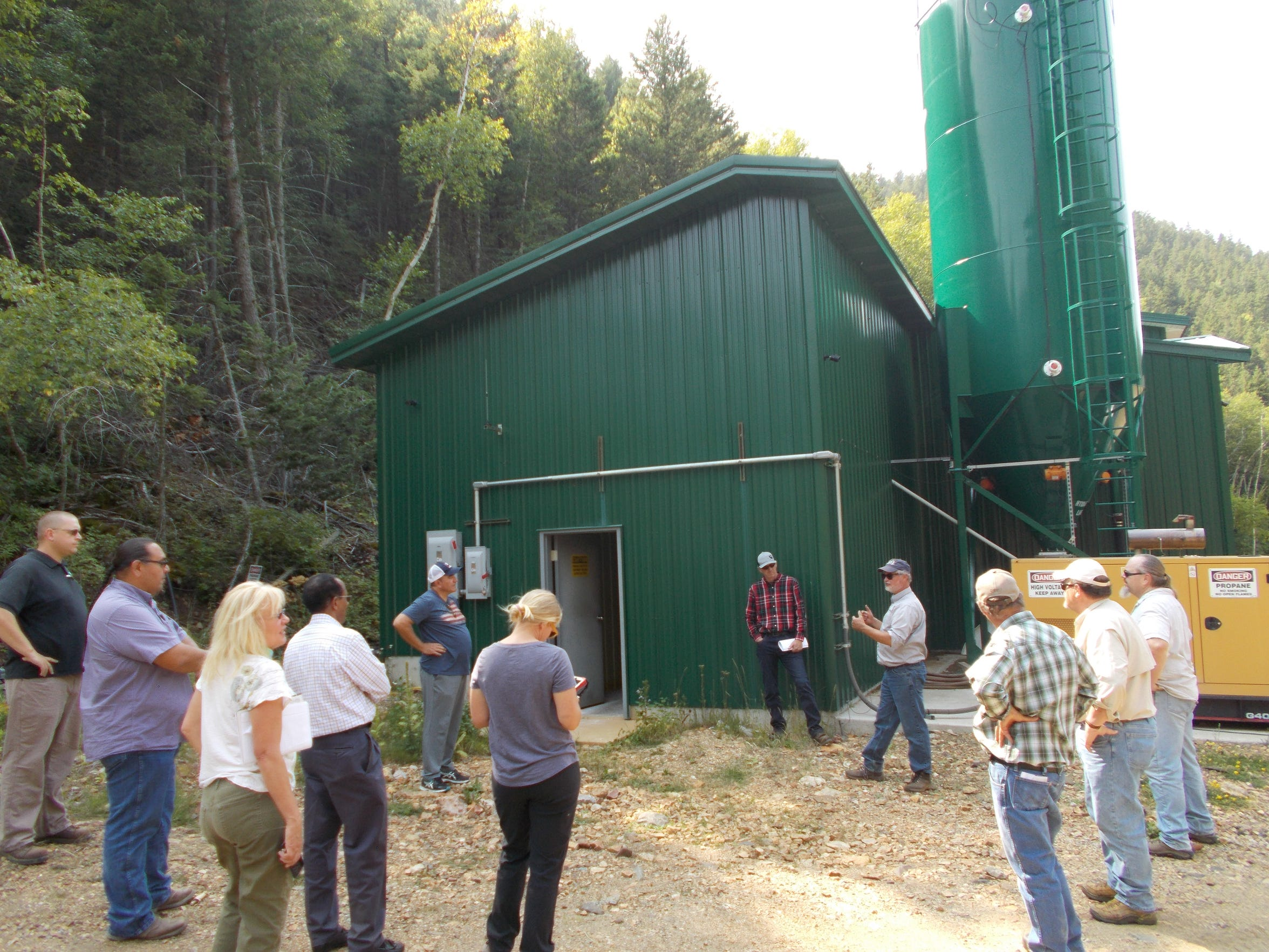 Wayne Jepson of the state Department of Environmental Quality explains how the Swift Gulch Water Treatment Plant works during a tour.