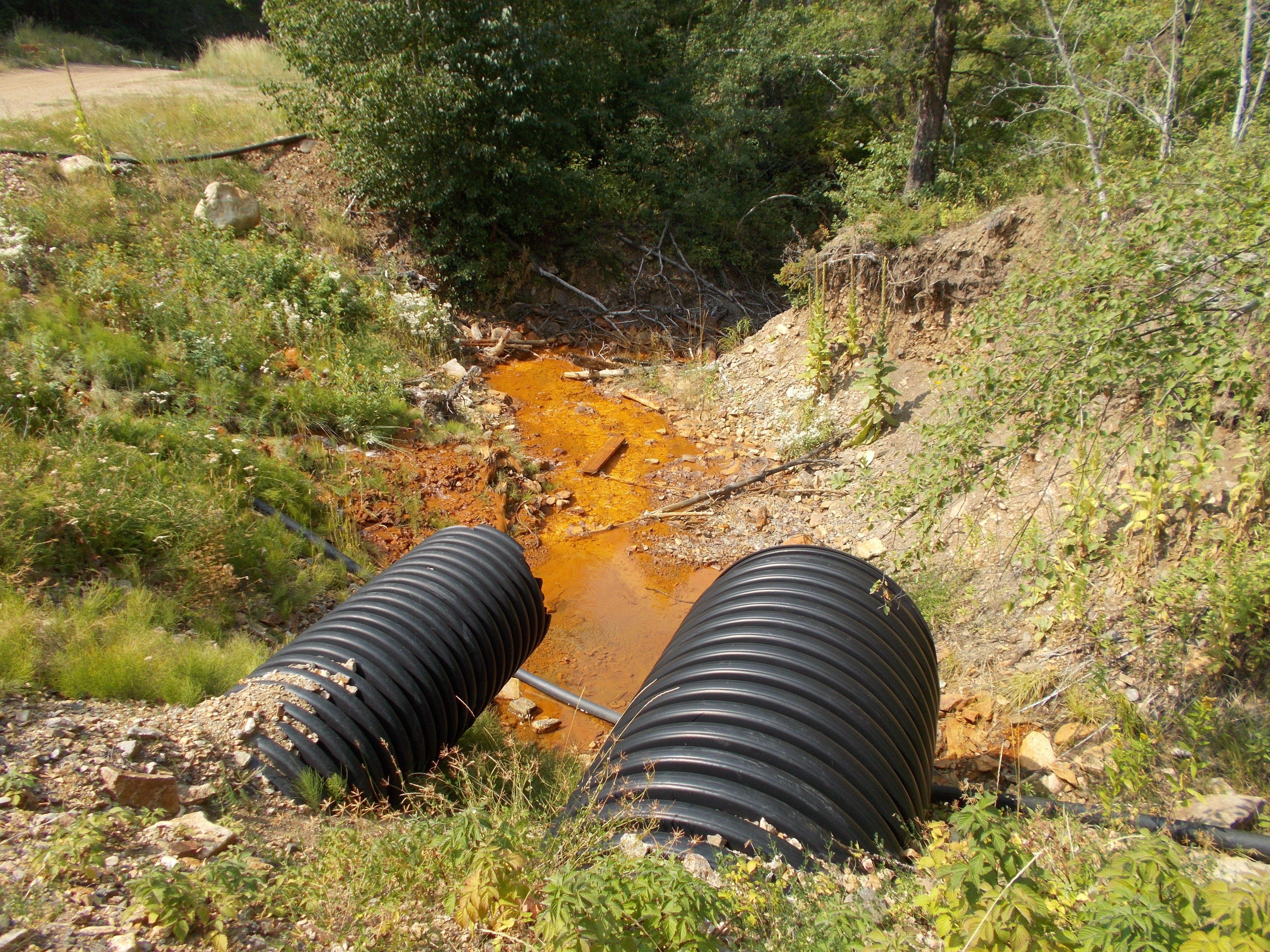 Polluted water treated at the Swift Gulch Water Treatment Plant in the Little Rocky Mountains is discharged into South Big Horn Creek.