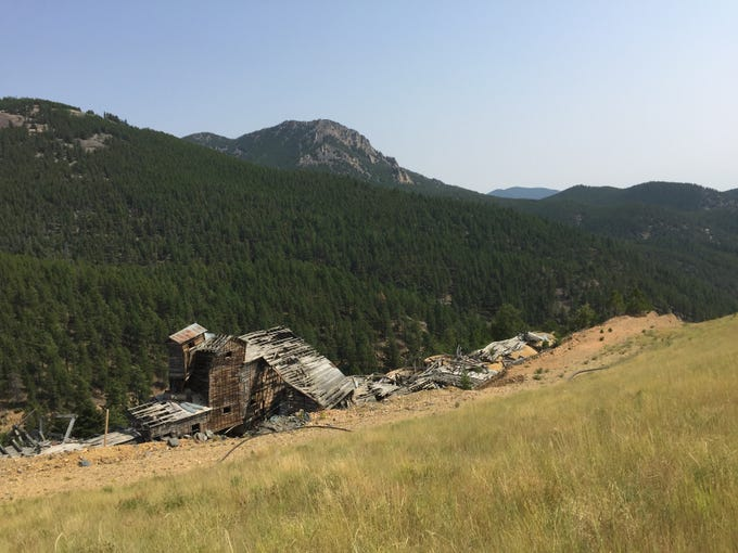 The Ruby Gulch historical mill as it deteriorates over time. More than 660,000 cubic yards of cyanide vat leach tailings were left in the drainage when the mine closed.