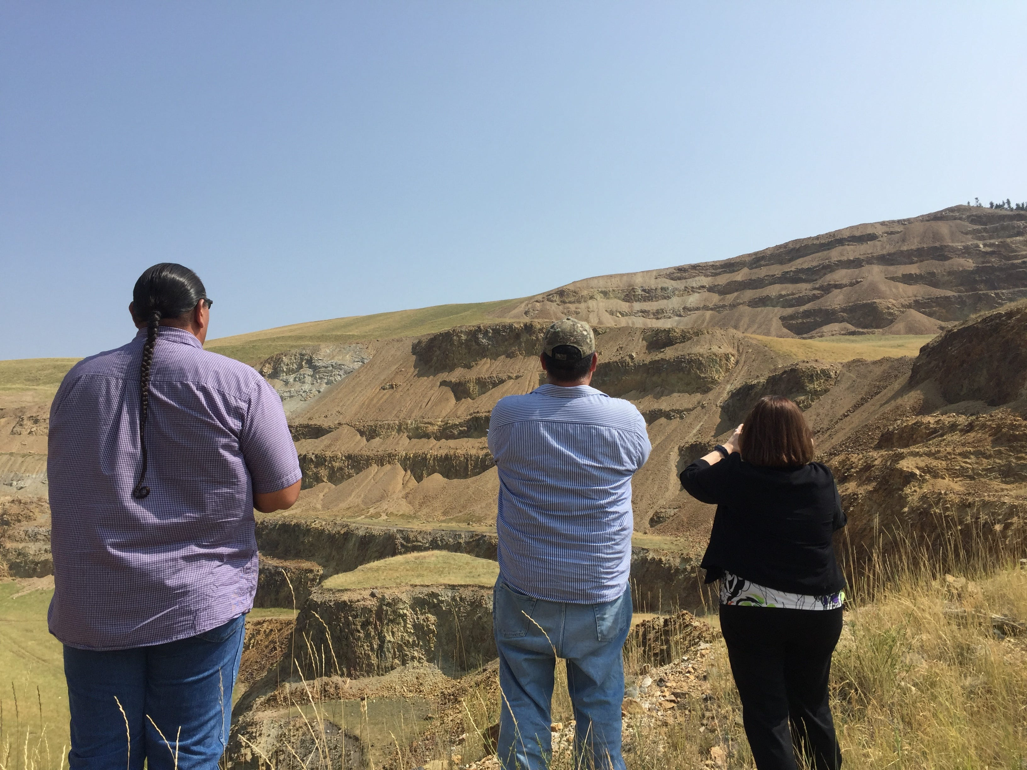 During a tour of the Zortman and Landusky mines in August, participants snapped photos of the Landusky pit as bighorn sheep scrambled on its steep slopes.