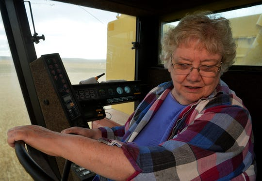 """Myrna Paulus harvests wheat in her New Holland TR 86 combine that she named """"Judy"""", Thursday, August 30, 2018."""
