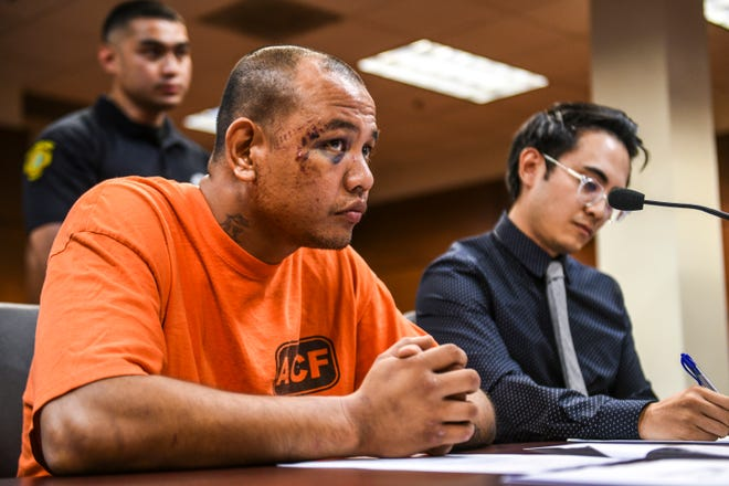 Kidnapping suspect Brian Keith Cruz, front, appears before Magistrate Judge Benjamin Sison Jr. during his magistrate hearing at the Superior Court of Guam in Hagåtña on Wednesday, Sept. 5, 2018.