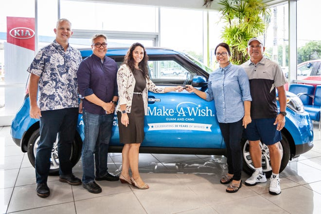Leah Duenas accepts the keys to her 2019 Kia Soul EX, from Triple J and Make-A-Wish at the Triple J showroom on Aug. 31. Standing from left,  Jay Jones, Eric Tydingco, Ana Marie Gayle, Leah Duenas and her husband Alvin.