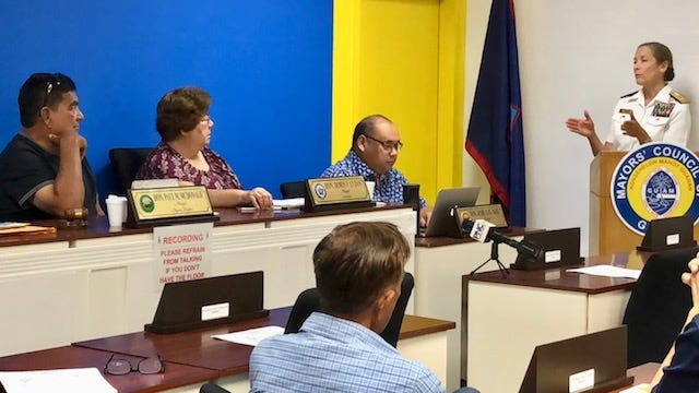 Rear Admiral Shoshana Chatfield, commander of Joint Region Marianas, talks about natural resources conservation and protection as part of the Marine realignment on island, during Wednesday's regular monthly meeting of the Mayors' Council of Guam.