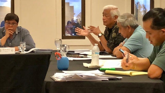 Guam Election Commission Chairwoman Alice Taijeron, left, listens as commissioner Joaquin Perez raises a point during Wednesday night's meeting. A motion to grant a request for  recount, by hand count, failed by a vote of 4-to-3.