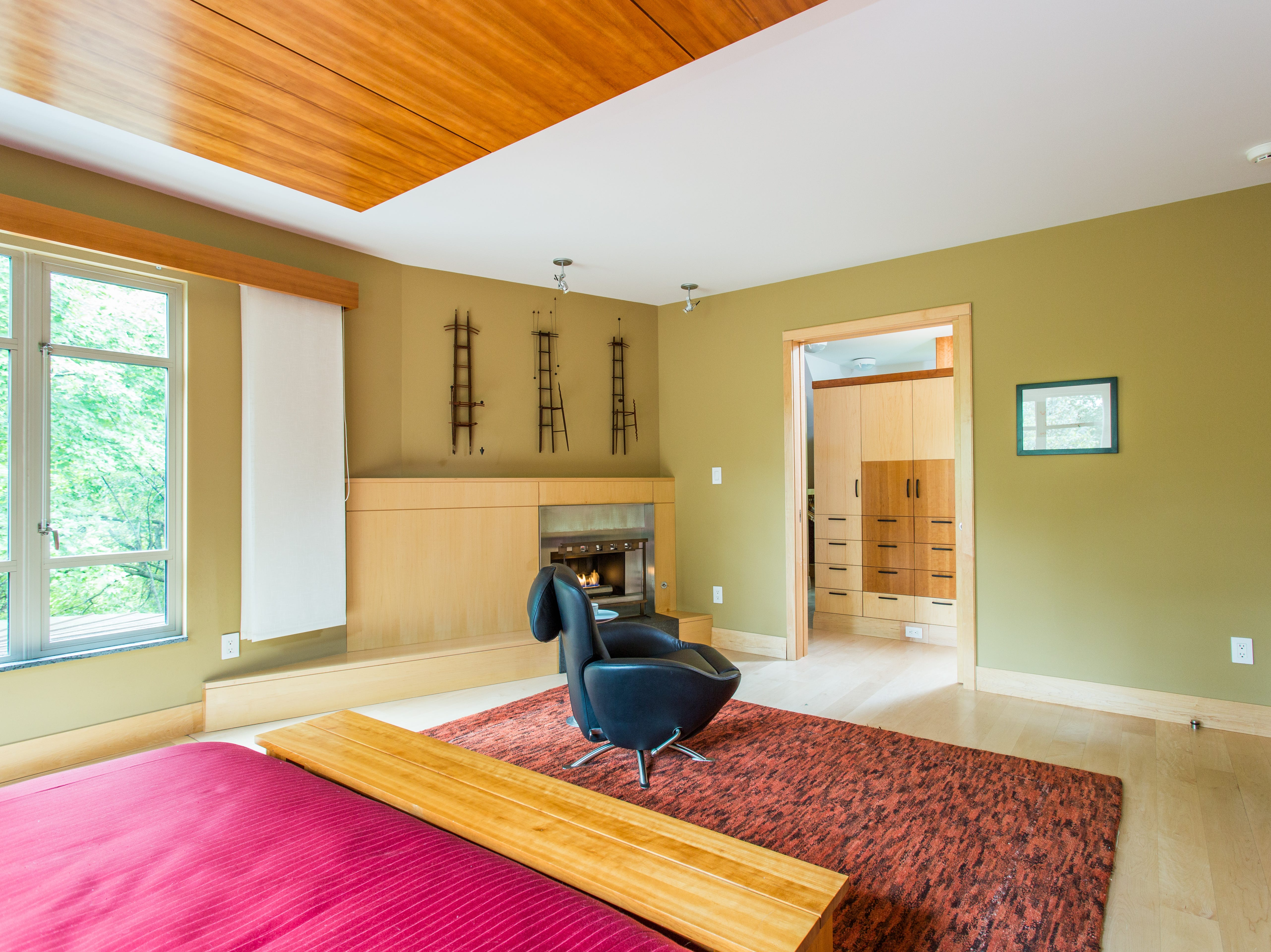 The master suite includes a fireplace and large custom closet.