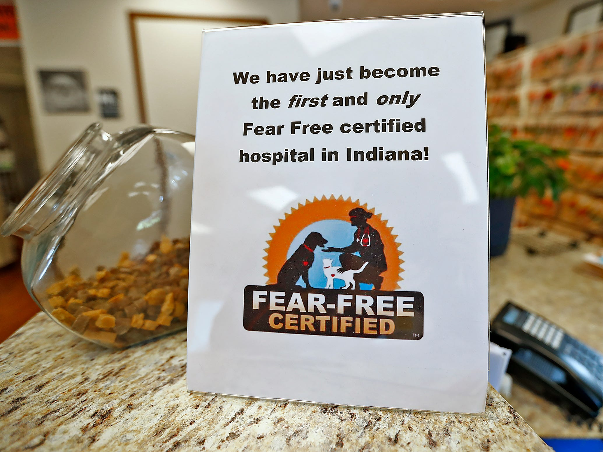 A sign indicates a Fear Free Certification at Paw Patch Place Animal Hospital, Friday, Aug. 31, 2018.  The veterinary clinic is the only one in Indiana to earn special fear free certification from an international program that aims to help vets reduce anxiety for pets prone to feel stressed in their offices.