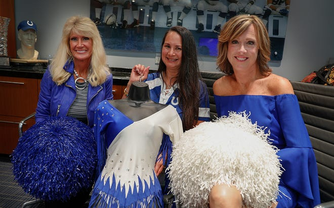 Three of the original Indianapolis Colts Cheerleaders Brenda Stapleton-Lummis, left, Laurie Young-Cutsinger and Dora Trittipo, right, 35 years after their first time cheering on the Colts.