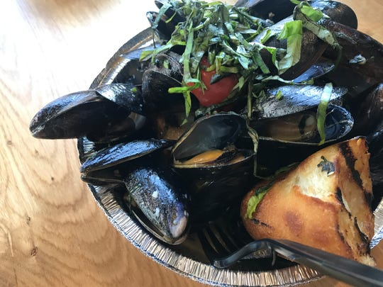 Mussels with basil, tomatoes, butter, roasted garlic and white wine at  The Den by FoxGardin, inside Sun King Taproom & Distillery in Carmel