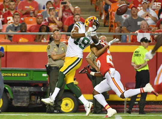 Aug 30, 2018;  Kansas City Chiefs cornerback Will Redmond (26) breaks up a pass intended for Green Bay Packers wide receiver Equanimeous St. Brown (19) during the first half at Arrowhead Stadium.