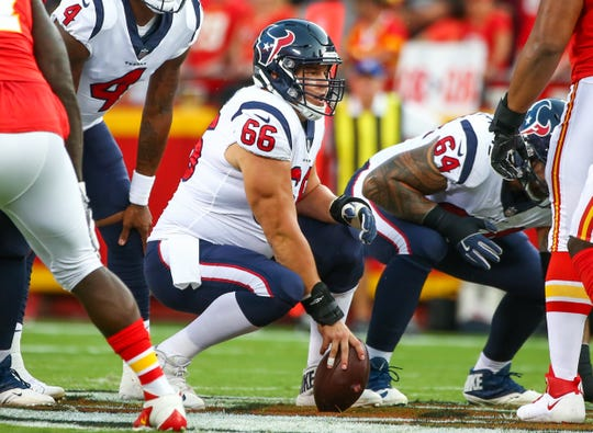 Aug 9, 2018;  Houston Texans center Nick Martin (66) checks the defense before the snap against the Kansas City Chiefs in the first half at Arrowhead Stadium.