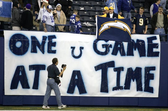 "Charger fans celebrated victory in front of a Colts poster stating ""One game at a time"" on Dec. 18, 2005."