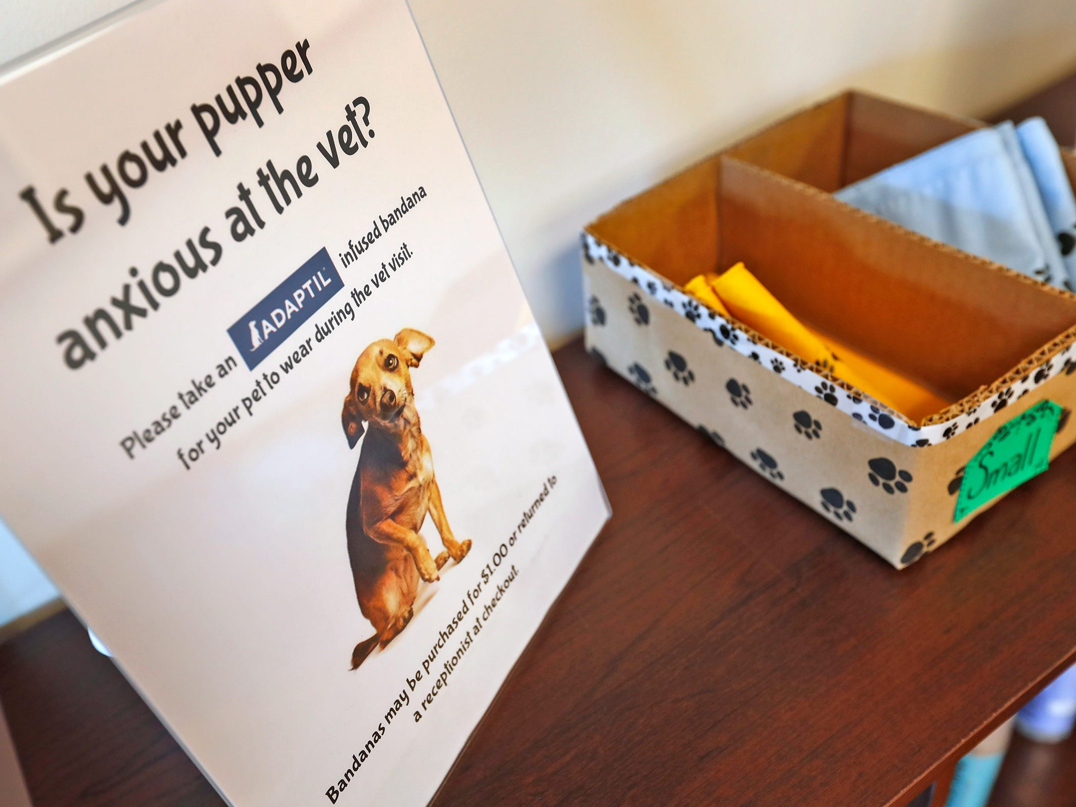 People can use or buy bandanas infused with a dog pheromone, at Paw Patch Place Animal Hospital, Friday, Aug. 31, 2018.  The veterinary clinic is the only one in Indiana to earn special fear free certification from an international program that aims to help vets reduce anxiety for pets prone to feel stressed in their offices.