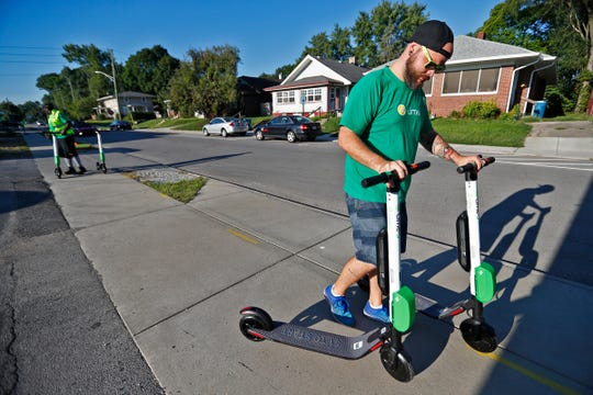 Nathan Hasse, Indianapolis Operations Manager for Lime, helps deploy Lime scooters in Broad Ripple, Wednesday, Sept. 5, 2018.