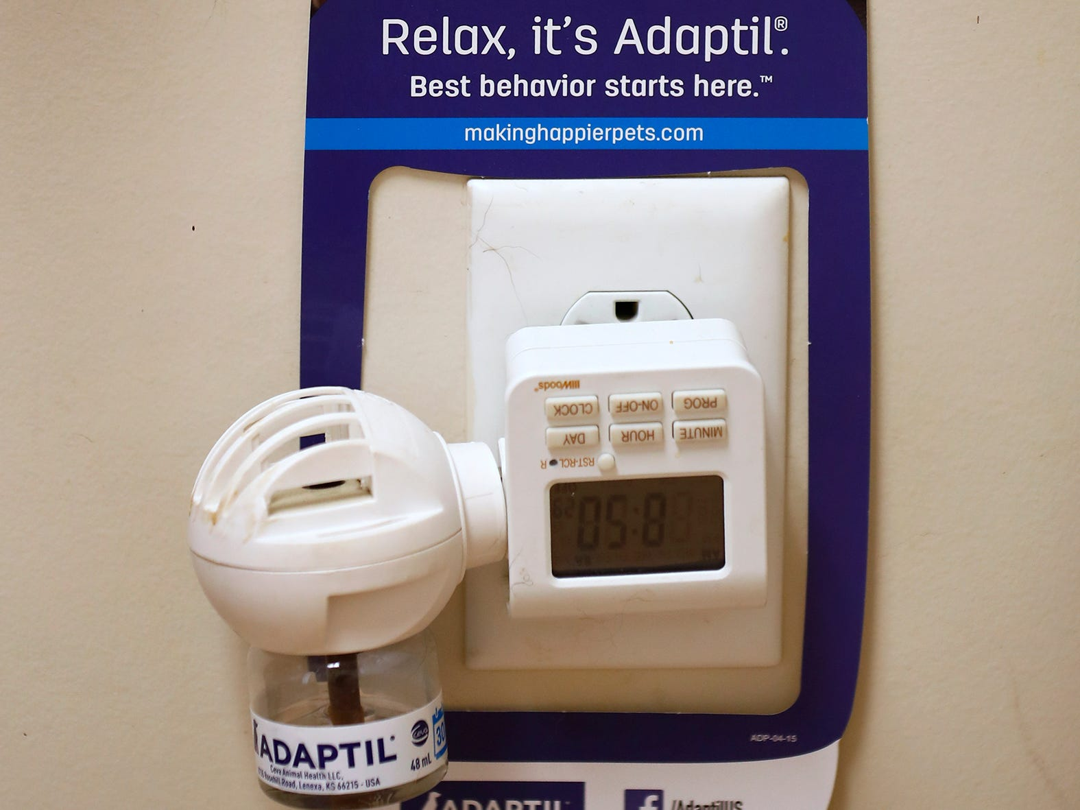 A plug in with Adaptil, a dog pheromone, is seen at Paw Patch Place Animal Hospital, Friday, Aug. 31, 2018.  They also have plug ins for cat pheromones. The veterinary clinic is the only one in Indiana to earn special fear free certification from an international program that aims to help vets reduce anxiety for pets prone to feel stressed in their offices.