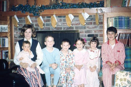 The Doyle kids at Christmas. Debby, Jenny (sitting on Debby's lap), Danny, Tim, Jody, Jamie, Mack.