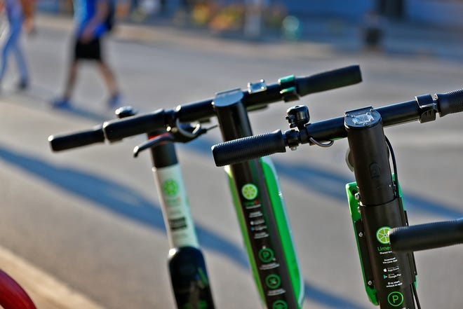 Lime scooters await riders in Broad Ripple, Wednesday, Sept. 5, 2018.
