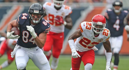 Aug 25, 2018;  Chicago Bears tight end Ben Braunecker (84) runs past Kansas City Chiefs cornerback Kendall Fuller (23) during the first half at Soldier Field.