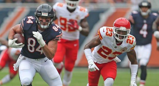 Aug 25, 2018;  Chicago Bears tight end Ben Braunecker (84) runs past Kansas City Chiefs cornerback Kendall Fuller (23) during the first half at Soldier Field.