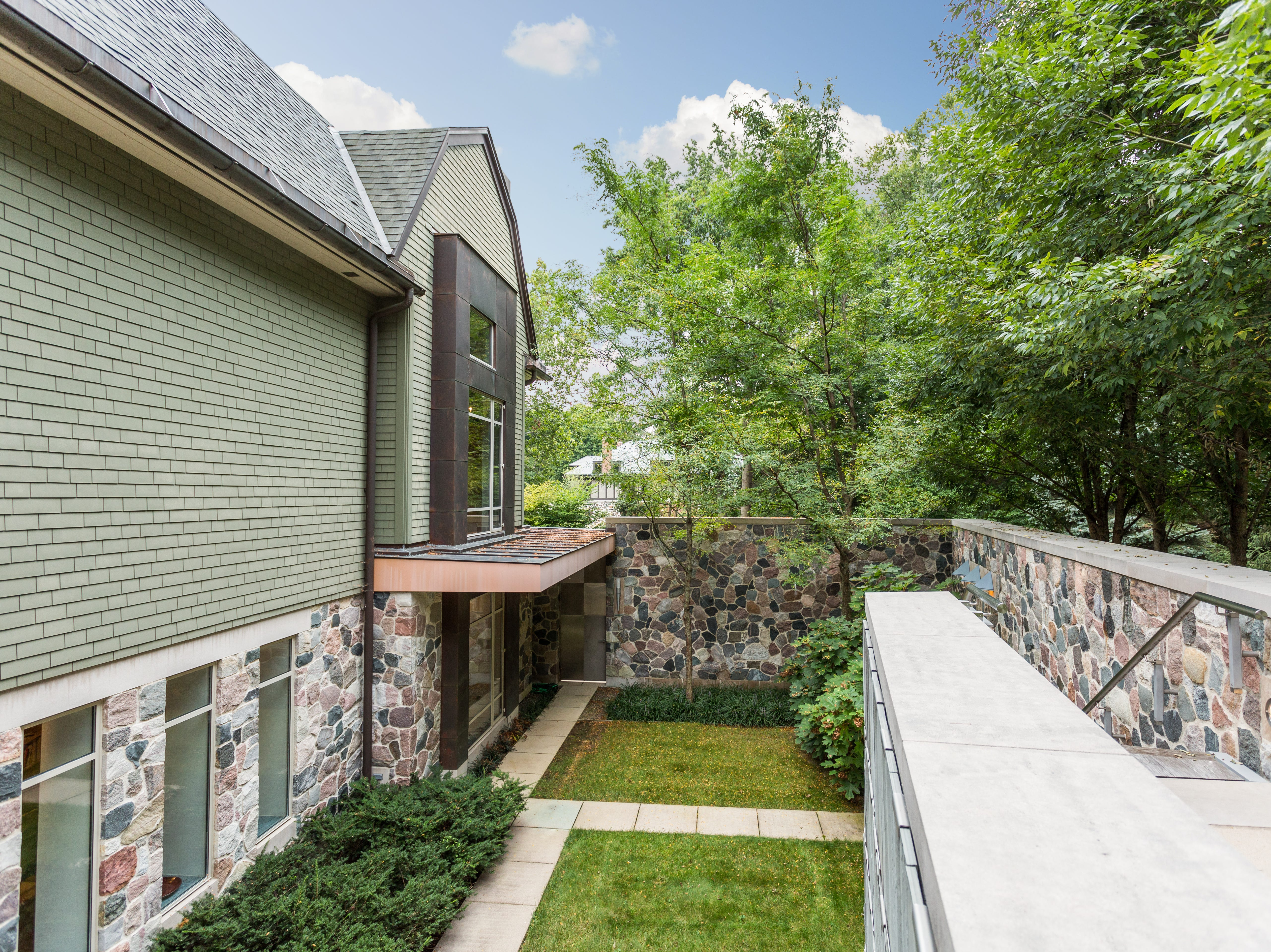A stone wall and trees afford privacy at the northwest-side home.