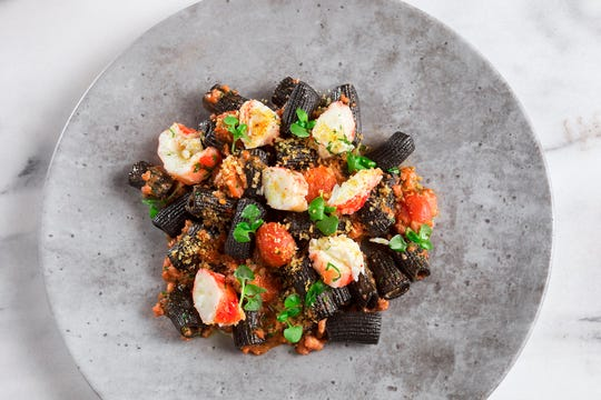 Squid ink rigatoni with spicy king crab in calamari ragu at chef Scott Conant's Masso Osteria in Las Vegas.