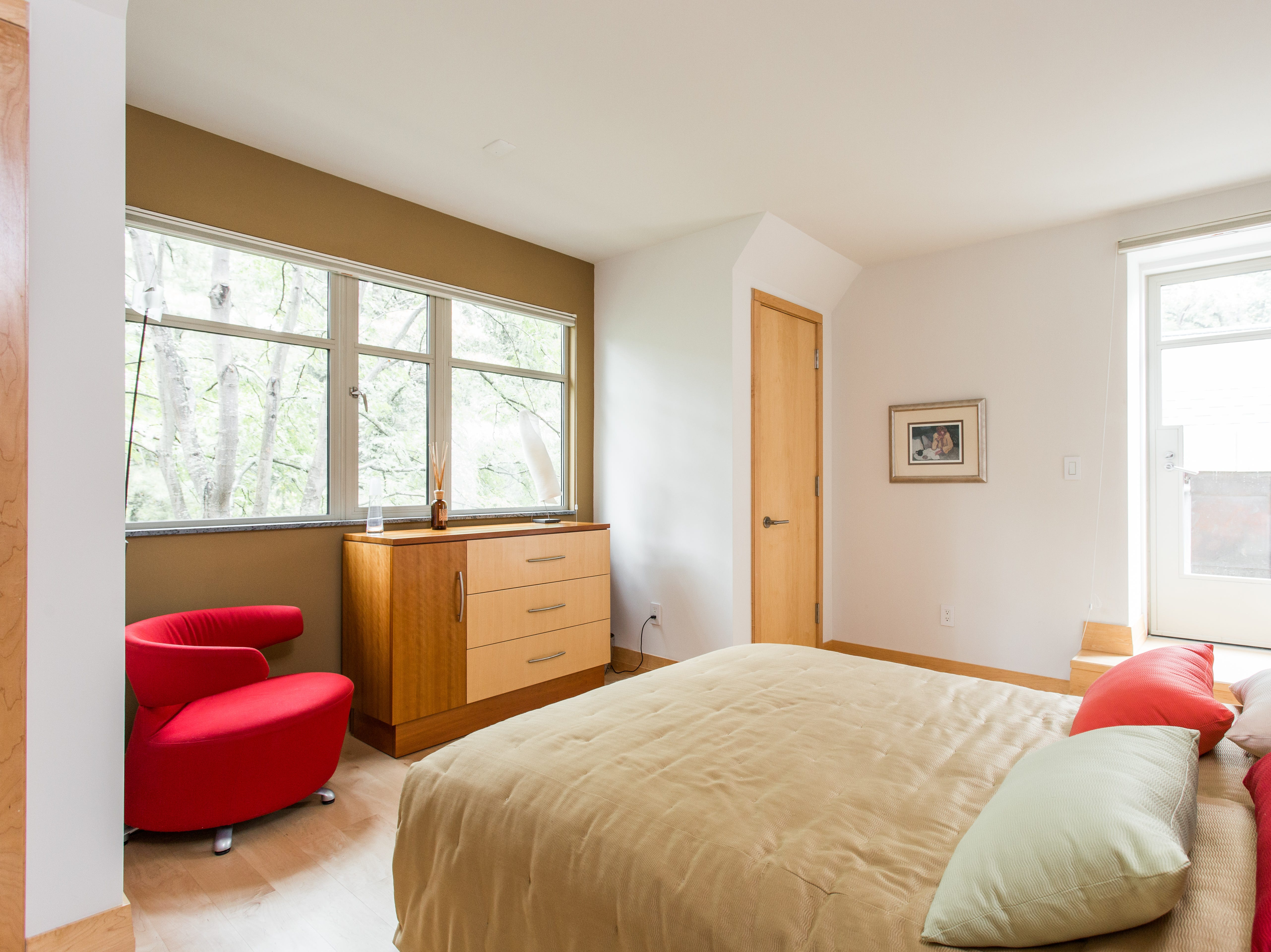 A guest room features a small balcony.