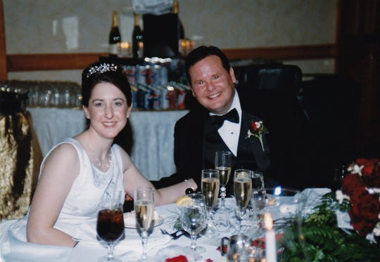 Tim and Becky Doyel at their wedding reception on Feb. 23, 2002. Photo courtesy of Doyle family.