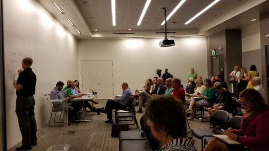 Business owners and city stakeholders question representatives from Bird and Lime, scooter companies operating their dockless service in Downtown Indianpaolis.