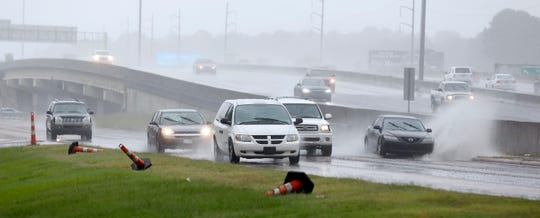 Accumulated rain from what is now Tropical Depression Gordon, makes for a big splash across a frontage road along I-55 in Jackson, Miss., Wednesday, Sept. 5, 2018. Weather forecasts have much of the central part of the state dealing with Gordon's rain until the weekend. (AP Photo/Rogelio V. Solis)