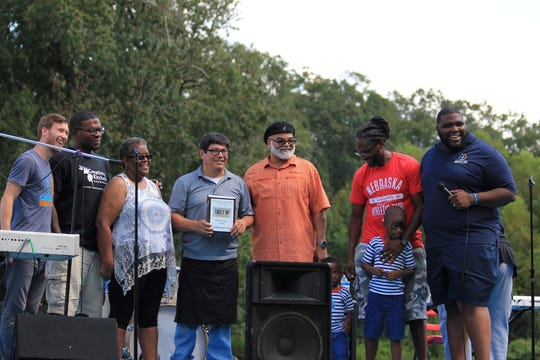 Clemente Ochoa, left of center, of Taqueria La Reata holds the Judge's Choice Award for the Taste of West Jackson 2017. With him are, from left, Alan Grove, Nick Wallace, Lee Harper, Pastor Calvin Waddy, Micah Briggs and Pastor John P. Perkins.