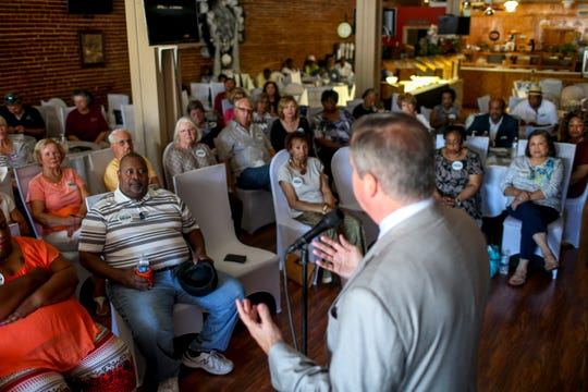 Crowd members gathered from around West Tennessee listen o Democratic gubernatorial candidate Karl Dean answer questions from the public at a town hall at Brownsville Family Restaurant in Brownsville, Tenn., on Tuesday, Sept. 4, 2018.