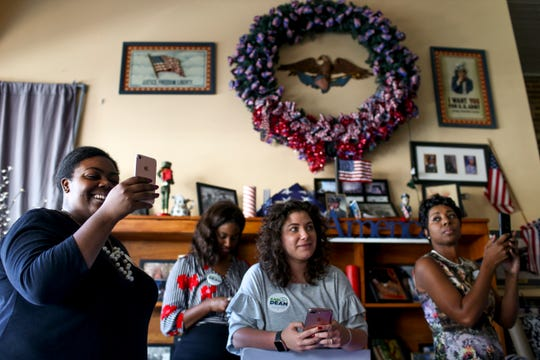Campaign staff Gabrielle Taylor, left, Paige Hill, second left, Elizabeth Henderson, middle, and Democratic candidate running for U.S. Congress (TN-District 8) Erika Stotts Pearson, right, take video on their phones and listen to Democratic gubernatorial candidate Karl Dean at a town hall at Brownsville Family Restaurant in Brownsville, Tenn., on Tuesday, Sept. 4, 2018.