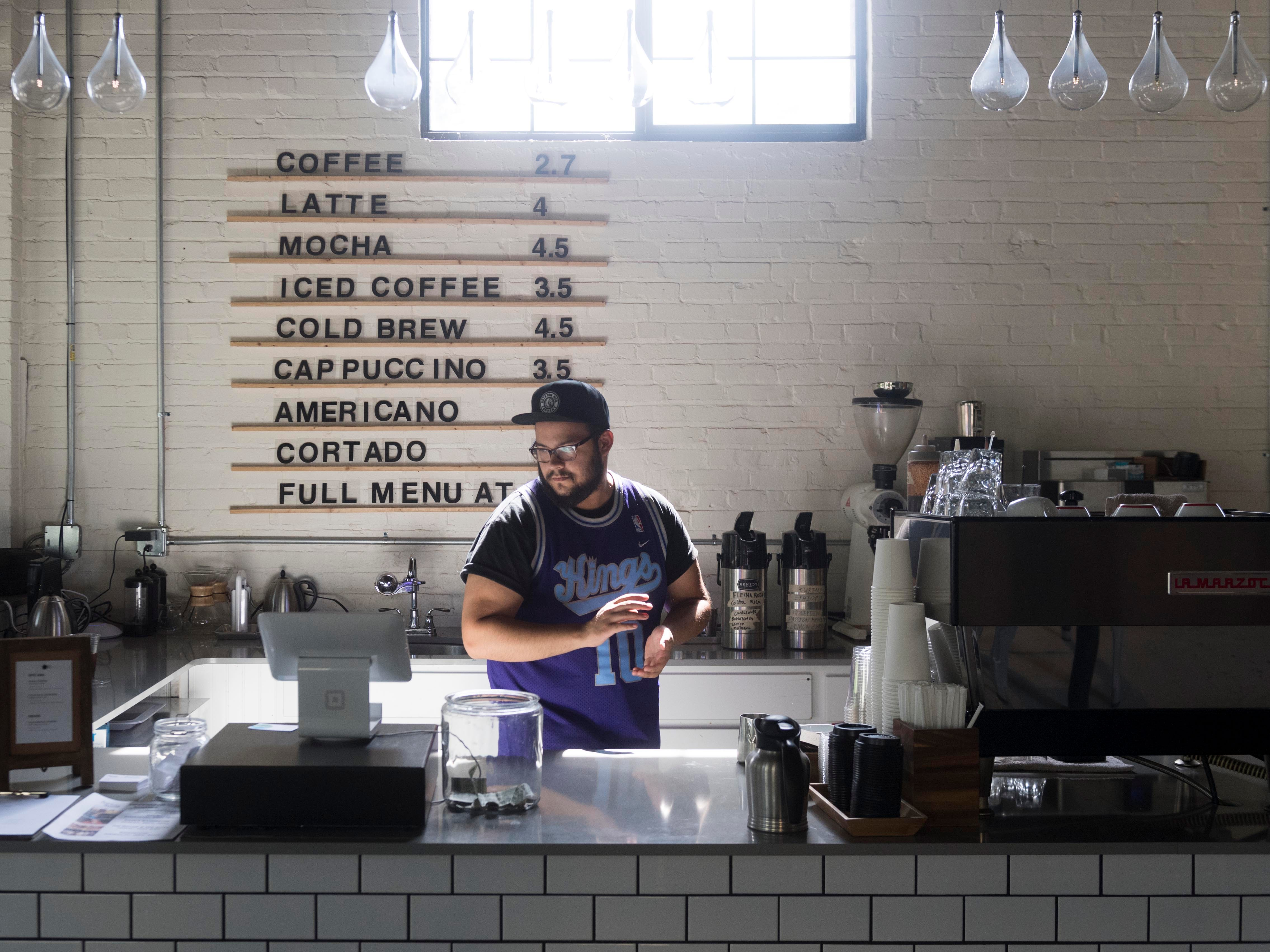 Clint Mailo, barista at Remedy Coffee on Saturday, September 1, 2018.