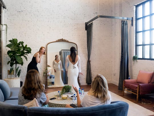 Rachel Duff is complimented by Madelyn Cunningham and friends Sydney Scaggs, left, and Logan Smith as Duff tries on wedding dresses at Cunningham's shop, Kindred Bridal  on Saturday, September 1, 2018.