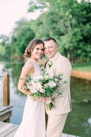 Whitney and Zach Bates pose during their vow renewal ceremony.