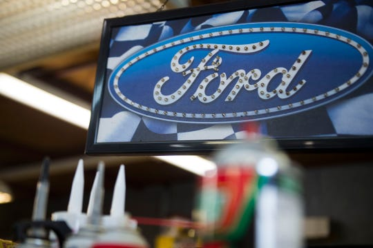 A Ford logo hangs in Krawlers Edge, which specializes in Ford Bronco restoration, in Seymour on Friday, Aug. 31, 2018. The shop became officially licensed by Ford Motor Co.
