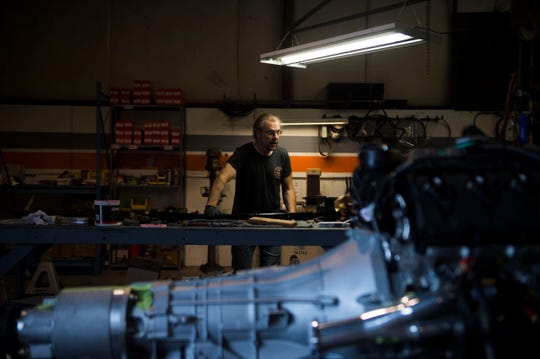 Victor Griffin stands at a work bench at Krawlers Edge, which specializes in Ford Bronco restoration, in Seymour on Friday, Aug. 31, 2018.