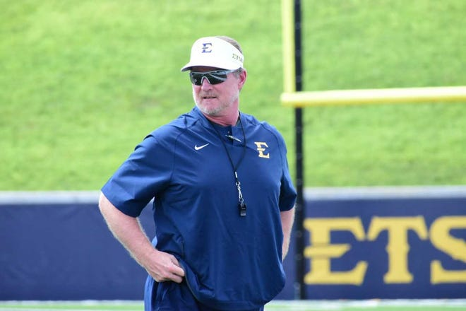 ETSU football coach during a recent practice in Johnson City. Johnson played quarterback at Tennessee and later was an assistant coach for the Vols.