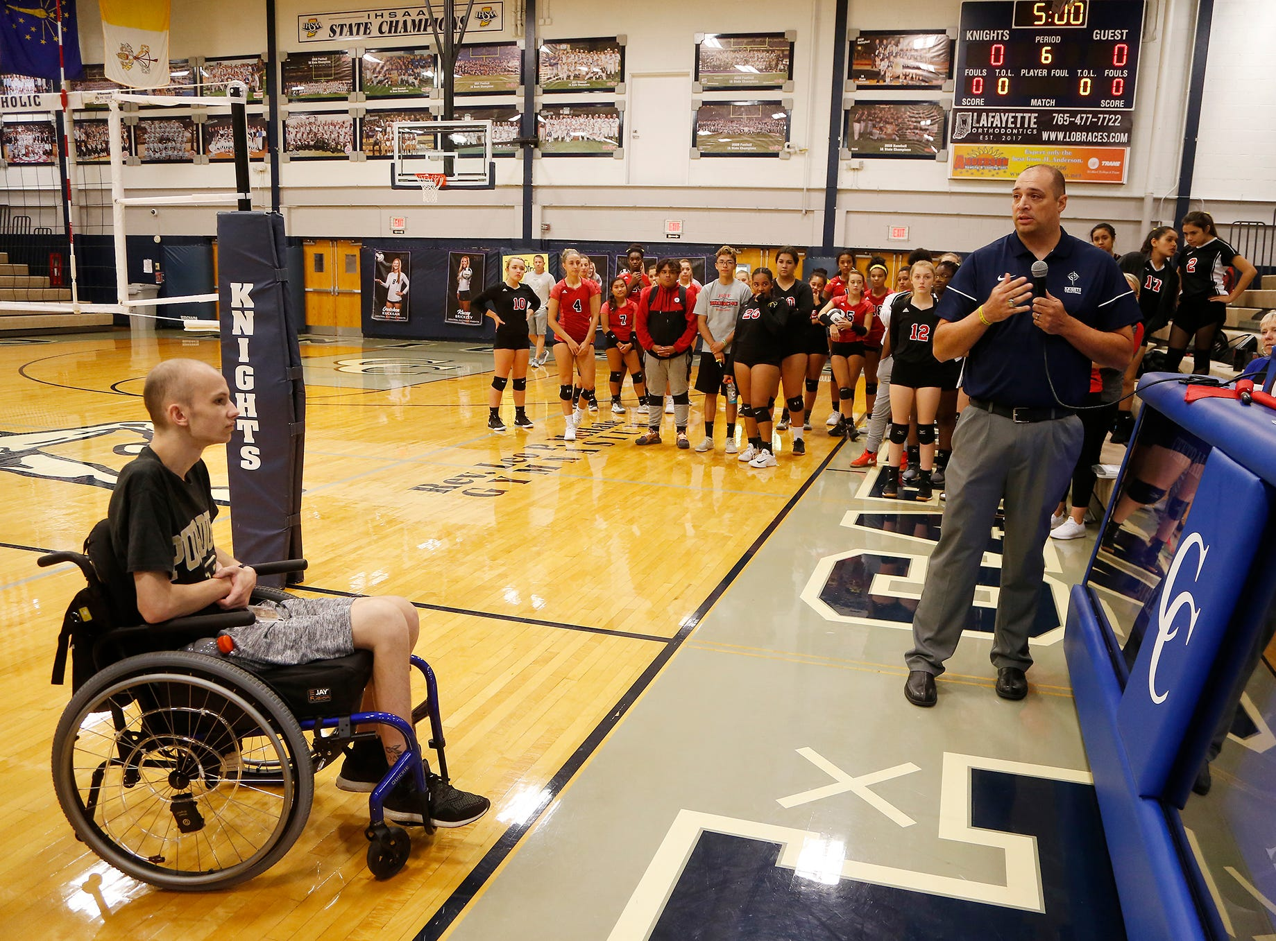 Central Catholic head coach Brad McCarter says a few words on behalf of Tyler Trent, left, before the Knights and Lafayette Jeff meet up to Spike Out Cancer Tuesday, September 4, 2018, in Lafayette. Trent is a Purdue sophomore battling cancer. CC defeated Jeff 25-14, 25-17, 25-13.