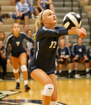 Lilly Powers of Central Catholic keeps the ball in play as the Knights face Lafayette Jeff to Spike Out Cancer Tuesday, September 4, 2018, in Lafayette. CC defeated Jeff 25-14, 25-17, 25-13.
