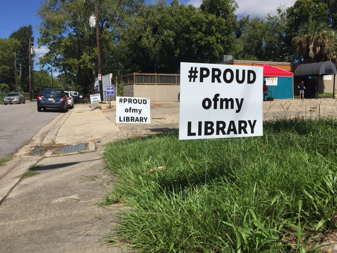 Signs in support of the Lafayette Public Library are seen on McKinley Street near Bolt Bar and Patio on Sept. 5, 2018.