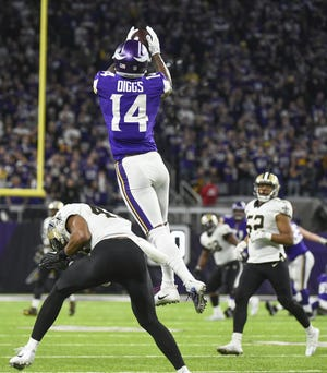 Minnesota Vikings wide receiver Stefon Diggs catches a game winning touchdown pass over New Orleans Saints free safety Marcus Williams.  EPA-EFE epaselect epa06439188 Minnesota Vikings wide receiver Stefon Diggs catches a game winning touchdown pass over New Orleans Saints free safety Marcus Williams during the fourth quarter of the NFC Divisional Playoffs at US Bank Stadium in Minneapolis, MN., USA, 14 January 2018.  EPA-EFE/CRAIG LASSIG