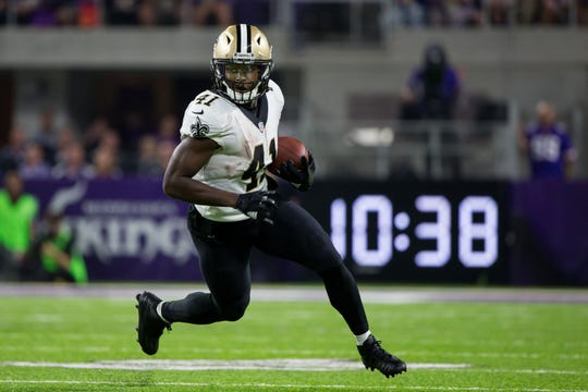 Saints running back Alvin Kamara rushes against the Vikings at U.S. Bank Stadium.  Brad Rempel-USA TODAY Sports Sep 11, 2017; Minneapolis, MN, USA; New Orleans Saints running back Alvin Kamara (41) runs with the ball in the fourth quarter against the Minnesota Vikings at U.S. Bank Stadium. Mandatory Credit: Brad Rempel-USA TODAY Sports