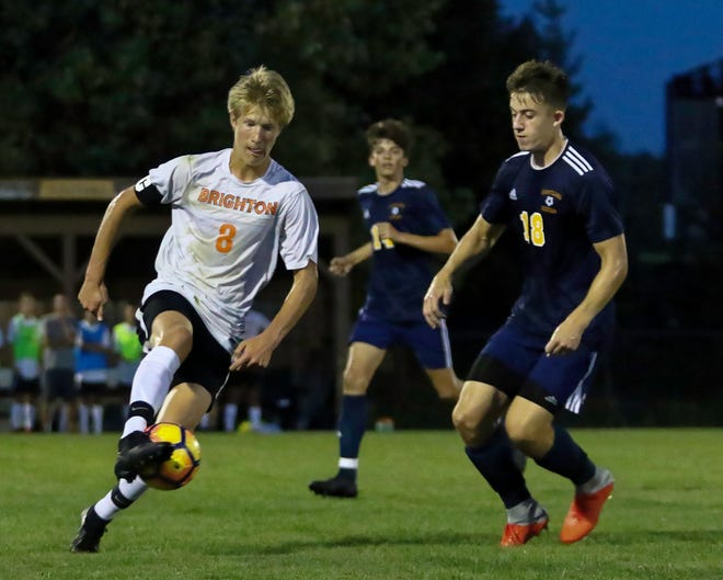 Brighton's Charlie Sharp (8) moves the soccer ball against Hartland's Logan White (18) in the Bulldogs' 1-0 victory over the Eagles on Tuesday Sept. 4, 2018.