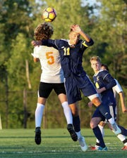 Hartland's Danny Parisien (11) and Brighton's Thomas Stanis (5) battle for the ball in the Bulldogs' 1-0 victory over the Eagles on Tuesday Sept. 4, 2018.