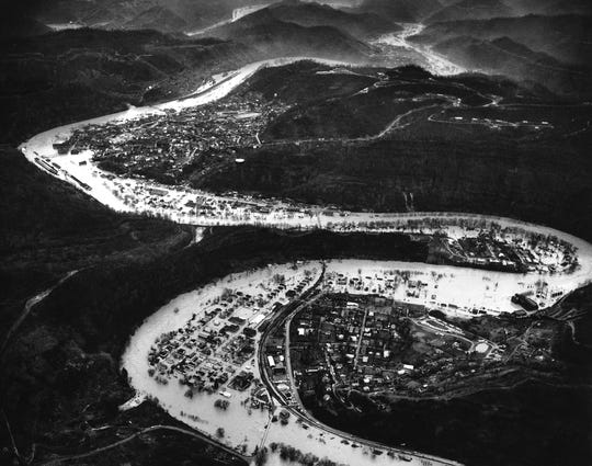 The towns of Lothair, foreground and Hazard in background are surrounded by flood waters from the North Fork of the Kentucky River. under flood conditions. By Billy Davis, The Courier-Journal. 1963.