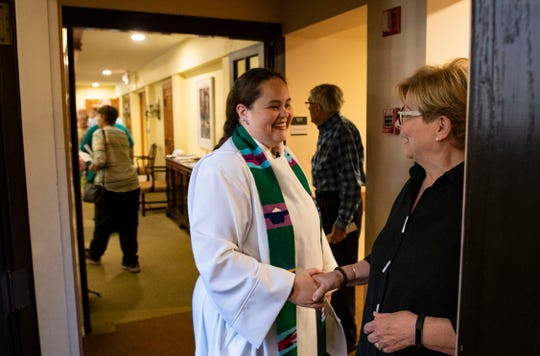 Rev. Doodle Harris greets a member of Highland Presbyterian Church before service on Sunday, July 29, 2018.