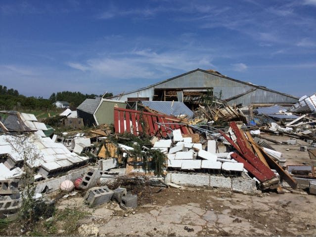 Damage to structures near Hollister and Round Lake roads in Bath Township caused by a tornado that hit Saturday night.